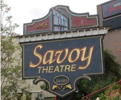 """Savoy Theatre sign at new entrance. Note the picture of the """"old"""" entrance at the top of the sign."""
