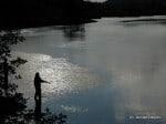 Fisherman casting his line