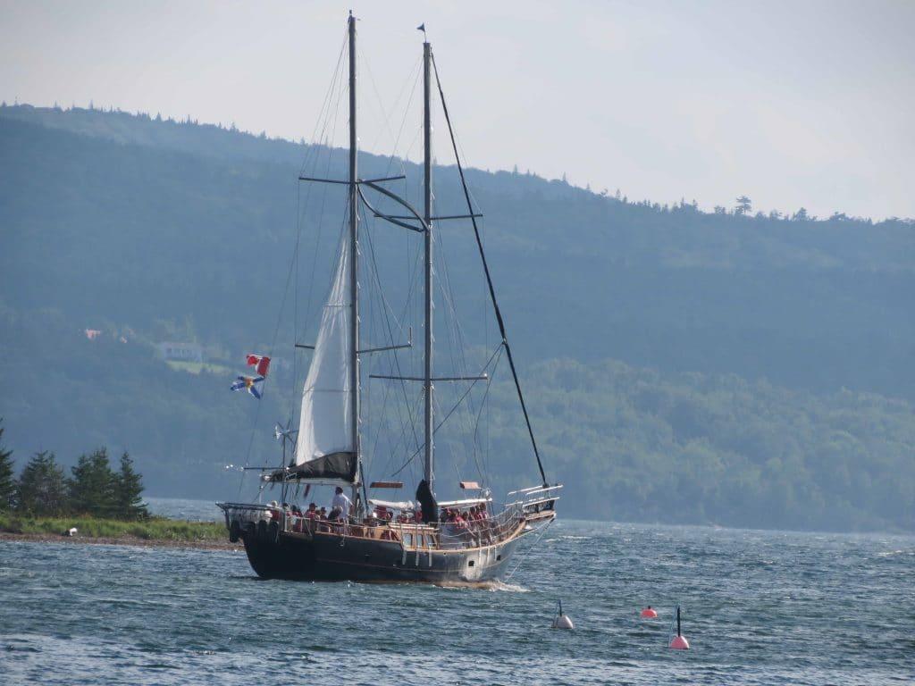 The Amoeba schooner sailing on the Bras d'Or Lake. Baddeck